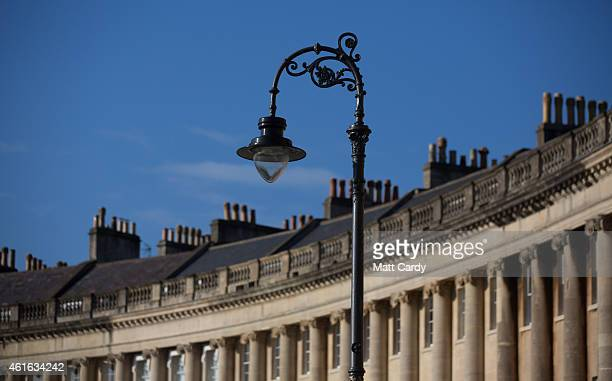 The sun illuminates property in the historic Royal Crescent on January 16 2015 in Bath England Although house prices are among the highest in the UK...
