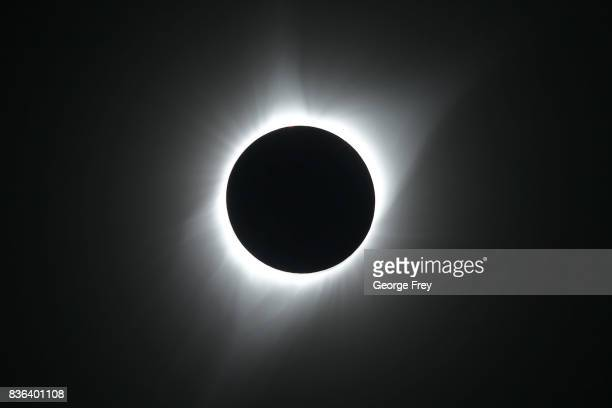 The sun is in full eclipse over Grand Teton National Park on August 21 2017 outside Jackson Wyoming Thousands of people have flocked to the Jackson...