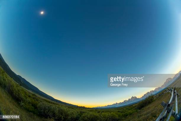 The sun is just coming out of full eclipse over Grand Teton National Park on August 21 2017 outside Jackson Wyoming Thousands of people have flocked...