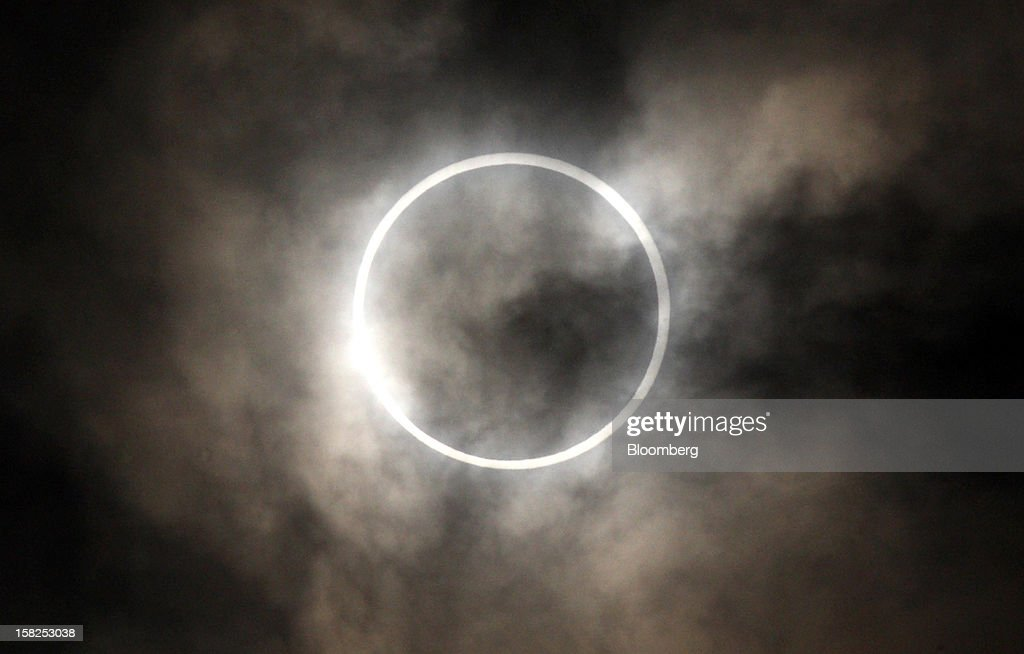 The sun is obscured by the moon during an annular solar eclipse in Tokyo, Japan, on Monday, May 21, 2012. An annular solar eclipse was observed in Japan today. Photographer: Tomohiro Ohsumi/Bloomberg via Getty Images