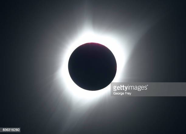 The sun is partially eclipsed in the first phase of a total eclipse in Grand Teton National Park on August 21 2017 outside Jackson Wyoming Thousands...
