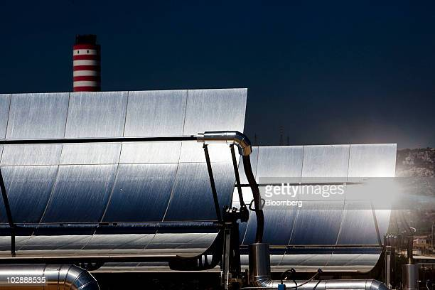 The sun is reflected in solar mirrors at Enel SpA's combined cycle thermodynamic solar power plant at its inauguration in Priolo Gargallo near...