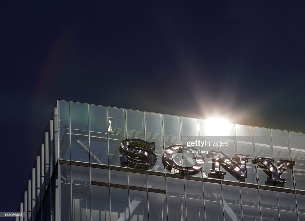 The sun is reflected on the Sony Corp. logo displayed on the company's headquarters in Tokyo, Japan, on Thursday, Nov. 1, 2012. Sony, Japan's biggest consumer-electronics exporter, unexpectedly posted its seventh straight quarterly loss on falling demand for its TVs as consumers flock to Apple Inc. and Samsung Electronics Co. devices. Photographer: Tomohiro Ohsumi/Bloomberg via Getty Images