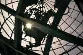 The sun is seen behind the Unisphere near the New York State Pavilion as part on a tour during festivities marking the 50th anniversary of the 1964...