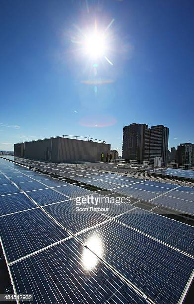 The sun reflects from solar panels on the rooftop at AGL's new Docklands office on August 20 2015 in Melbourne Australia The rooftop solar system...