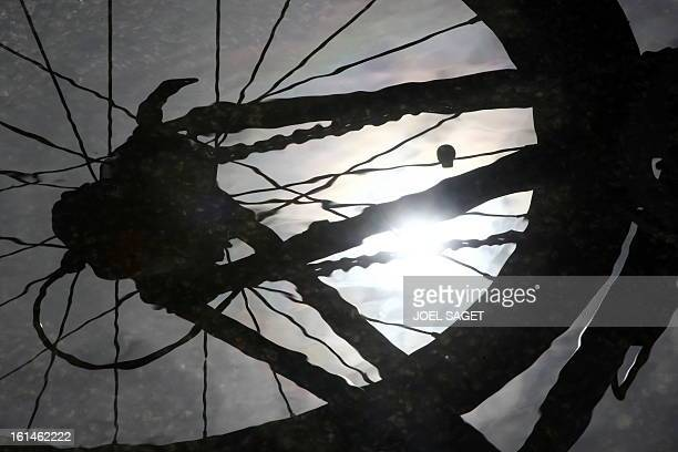 The sun reflects in the spokes of a bicycle on July 2 2008 in Brest Brittany western France three days before the official start of the 2008 Tour de...