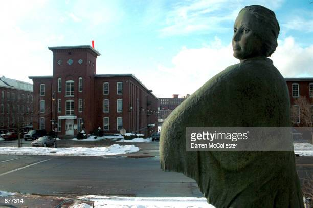 The sun reflects off Mill Girl statue January 16 which overlooks Amoskeag Millyards in Manchester NH The old textile and fabrics buildings are now...