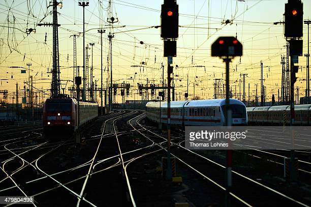 The sun reflects off train tracks at a railway junction on March 20 2014 in Frankfurt Germany Deutsche Bahn Europe's biggest rail carrier is...