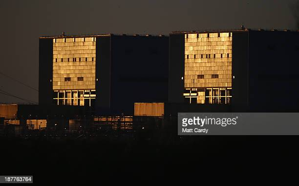 The sun reflects on the front of Hinkley Point A nuclear power station besides near Bridgwater on November 12 2013 in Somerset England EDF who last...