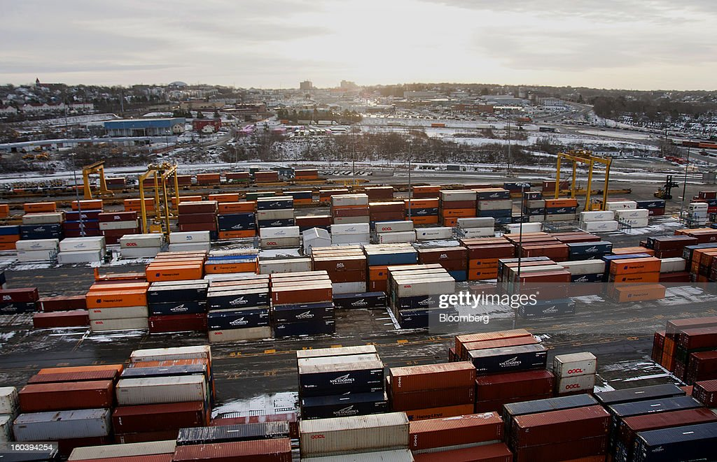The sun rises above freight containers stacked at the Port Of Halifax's Fairview Cove container terminal, operated by Cerescorp Co., in Halifax, Nova Scotia, Canada, on Wednesday, Jan. 30, 2013. Statistics Canada (STCA) is scheduled to release gross domestic product data on Jan. 31. Photographer: Aaron McKenzie Fraser/Bloomberg via Getty Images