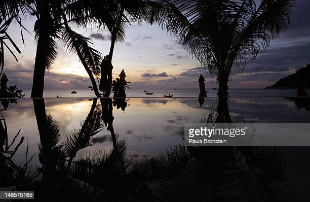 The sun rises along the beach at the Anantara Rasananda resort June 18 2012 on the island of Koh Phangan off the coast of Koh Samui Thailand's...