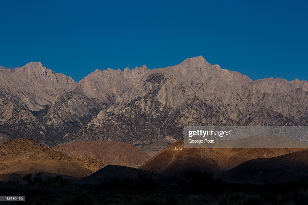 The sun rises along the Sierra Nevada Mountains as viewed from the Alabama Hills on July 22 near Lone Pine California The arid Owens Valley located...
