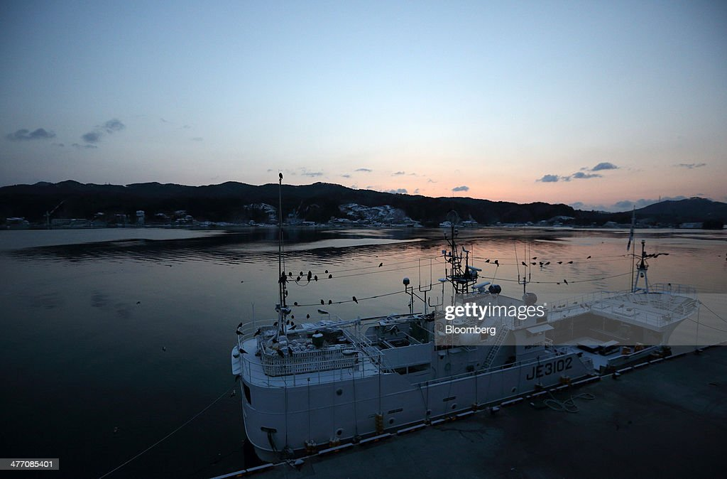 The sun rises as a fishing vessel is moored at the fish market in Kesennuma City, Miyagi Prefecture, on Friday, March 7, 2014. Reconstruction of Tohoku, the northern Japan region devastated by the March 11, 2011 earthquake and tsunami, continues as the third anniversary of the disaster approaches. Photographer: Tomohiro Ohsumi/Bloomberg via Getty Images