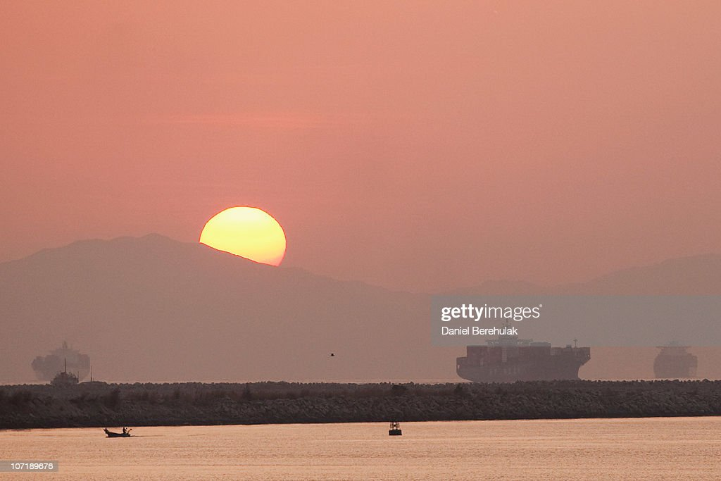 The sun rises as cargo ships navigate their way in and out of Shenzhen Port on November 28, 2010 in Shenzhen, China. According to the US Commercial Service, Shenzhen is one of the fastest growing cities in the world. Home of the Shenzhen Stock Exchange and the headquarters of numerous technology companies, the now bustling former fishing village is considered southern China's major financial centre.