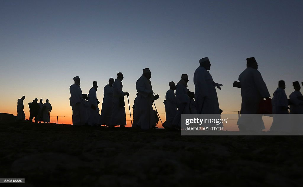 The sun rises as Samaritan worshipers gather to pray on top of Mount Gerizim near the northern West Bank city of Nablus to celebrate the Shavuot...