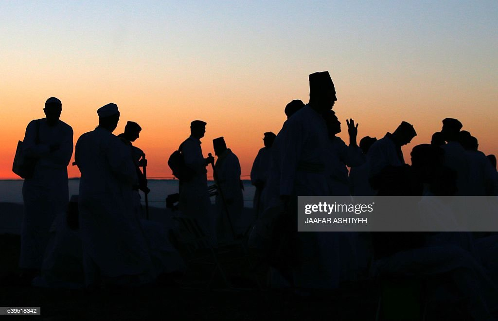TOPSHOT The sun rises as Samaritan worshipers gather to pray on top of Mount Gerizim near the northern West Bank city of Nablus to celebrate the...