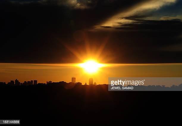 The sun rises as seen from Newton Massachusetts on October 1 2012 AFP PHOTO/Jewel Samad