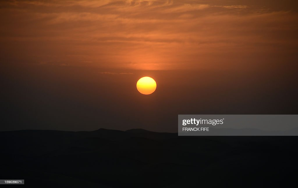 The sun rises before the start of the Stage 2 of the Dakar 2013 in Pisco, Peru, on January 6, 2013. The rally will take place in Peru, Argentina and Chile from January 5 to 20.