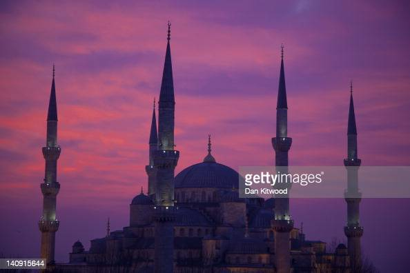 The sun rises behind the Blue Mosque in the Sultanahmet area of Istanbul on February 22 2012 in Istanbul Turkey Though not the capital Istanbul is...