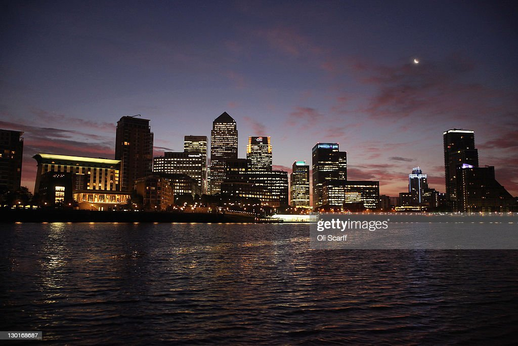 The sun rises behind the Canary Wharf skyscrapers on the Isle of Dogs on October 24, 2011 in London, England. The Canary Wharf financial district, which was constructed in the 1980s on the site of the derelict West India Docks, is home to the headquarters of numerous banks and financial institutions.