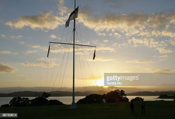 The sun rises behind the flag pole during the dawn service to celebrate Waitangi Day February 6 2006 in Waitangi New Zealand Waitangi Day is a public...