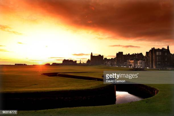 The sun rises behind the RA Clubhouse on the par 4 18th hole 'Tom Morris' on the Old Course at St Andrews on August 29 2009 in St Andrews Scotland