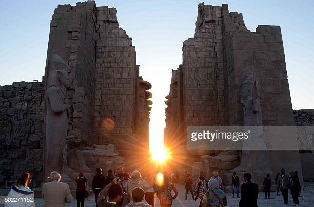 The sun rises behind the Temple of Karnak during the alignment of the winter solstice sunrise to the temple in the southern Egyptian city of Luxor on...