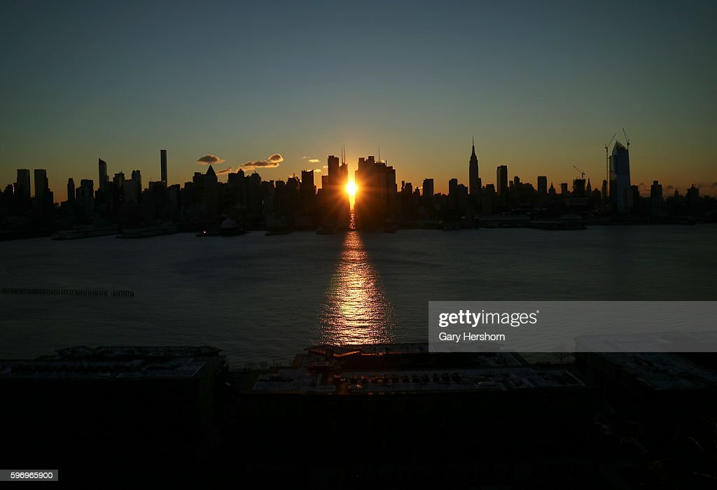 The sun rises down 42nd Street and across the Hudson River in New York January 19 2016