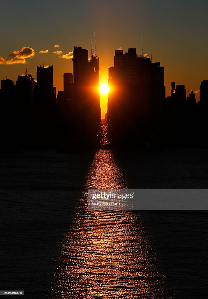 The sun rises down 42nd Street in New York January 19 2016