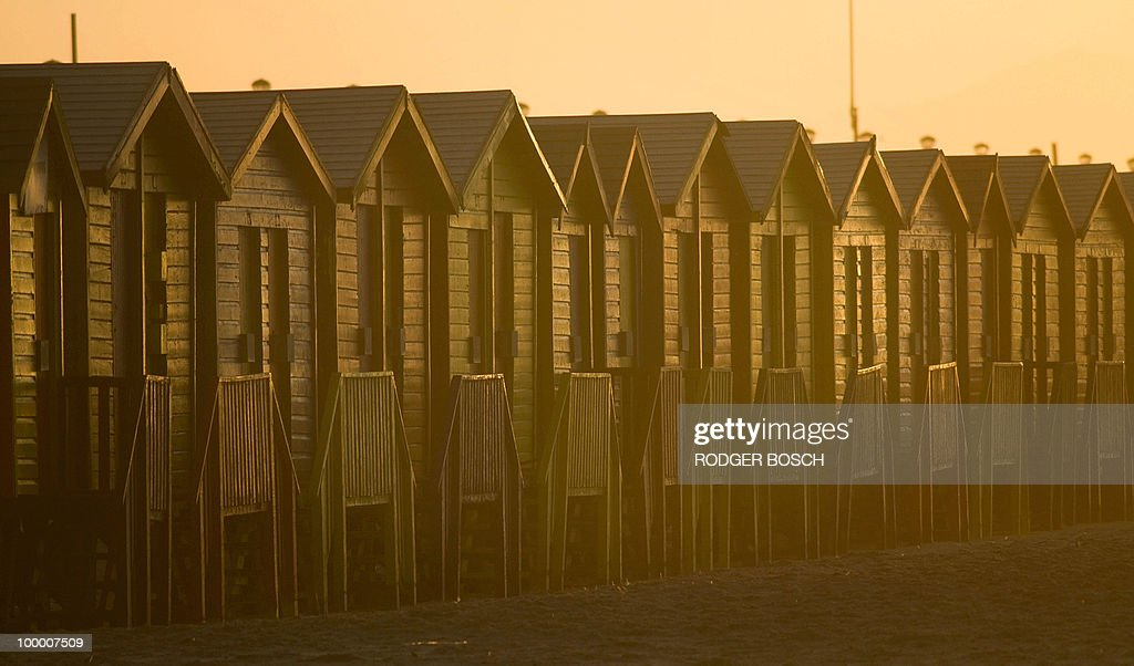 The sun rises on coloured bathing houses on May 19, 2010 at the Muizemberg beach on the outskirt of Cape Town, South Africa. South Africa will host the FIFA World Cup from the 11 of June to the 11 of July, 2010.