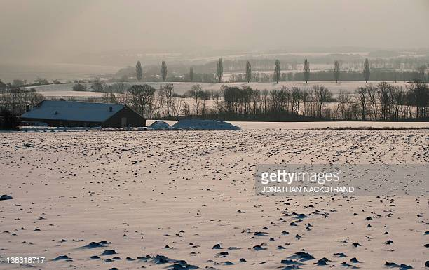 The sun rises on February 5 2012 in the village of Godhjem on the Danish island of Bornholm in the Baltic Sea The deadly cold snap that has gripped...