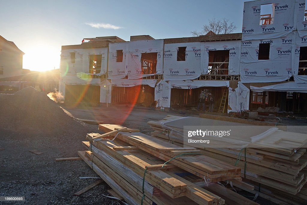 The sun rises on new Lexington Homes LLC townhomes under construction in Des Plaines, Illinois, U.S., on Monday, Jan. 14, 2013. The U.S. Census Bureau is scheduled to release housing starts figures on Jan. 17. Photographer: Tim Boyle/Bloomberg via Getty Images