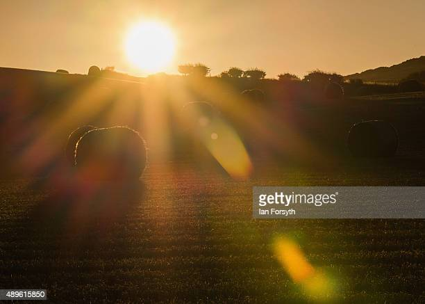 The sun rises over a hillside covered with hay bales on the first day of Autumn or the Autumn Equinox on September 23 2015 in Saltburn England An...