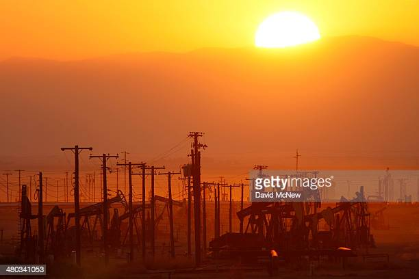 The sun rises over an oil field over the Monterey Shale formation where gas and oil extraction using hydraulic fracturing or fracking is on the verge...