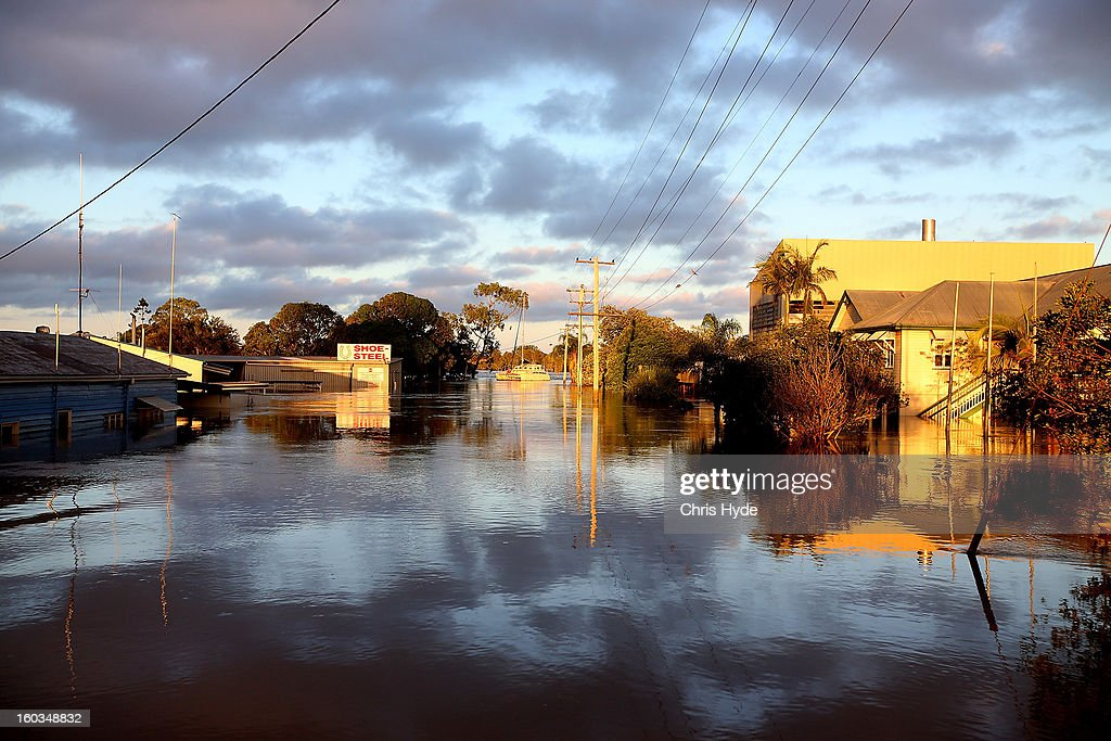 The sun rises over flooded streets as parts of southern Queensland experiences record flooding in the wake of Tropical Cyclone Oswald on January 30, 2013 in Bundaberg, Australia. Flood waters peaked at 9.53 metres in Bundaberg yesterday and began receding overnight, as residents and relief teams prepare to clean-up debris. Four deaths have been confirmed in the Queensland floods and the search is on for two men though to be missing in floodaters in Gatton.