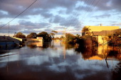 The sun rises over flooded streets as parts of southern Queensland experiences record flooding in the wake of Tropical Cyclone Oswald on January 30...