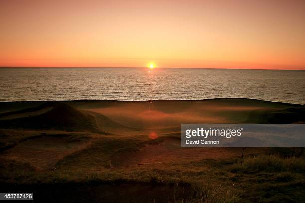 The sun rises over Lake Michigan and the green on the 249 yards par 3 17th hole 'Pinched Nerve' on the Whistling Straits Course venue for the 2015...