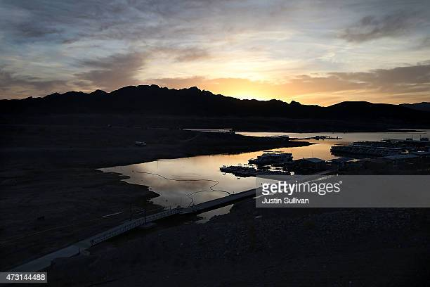 The sun rises over the Callville Bay Marina on May 12 2015 in Lake Mead National Recreation Area Nevada As severe drought grips parts of the Western...