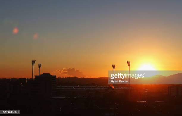 The sun rises over the Gabba before during day one of the First Ashes Test match between Australia and England at The Gabba on November 21 2013 in...