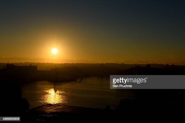 The sun rises over The Grand Harbour in Valletta on the final day of the Valletta Summit on November 12 2015 in Valletta Malta The Summit will bring...