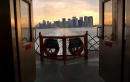 The sun rises over the Manhattan skyline September 10 2002 as seen from the Staten Island ferry in New York City As the one year anniversary of...