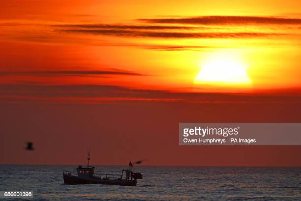 The sun rises over the North Sea at Tynemouth as forecasters predict that a wave of warm air will move across the country in the coming days