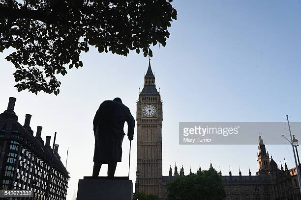 The sun rises over the the statue of Winston Churchill and Houses of Parliament as votes are counted and show that the United Kingdom is forecasted...