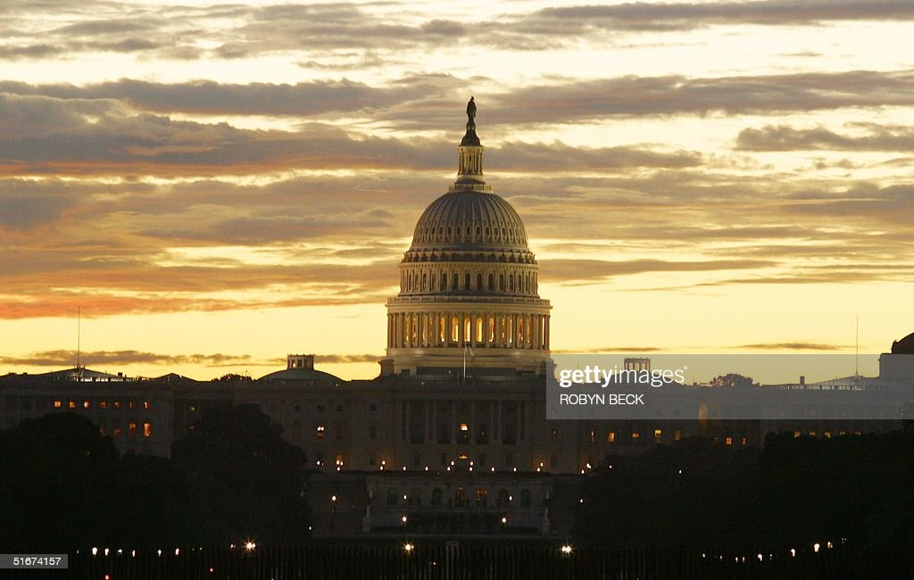 The sun rises over the United States Capitol on the Mall in Washington DC 10 September 2002 The US Capitol building an example of 19thcentury...