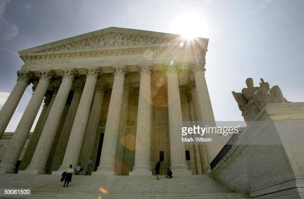 The sun rises over the US Supreme Court June 13 2005 in Washington DC The court refused to hear the case of terror suspect Jose Padilla today as well...