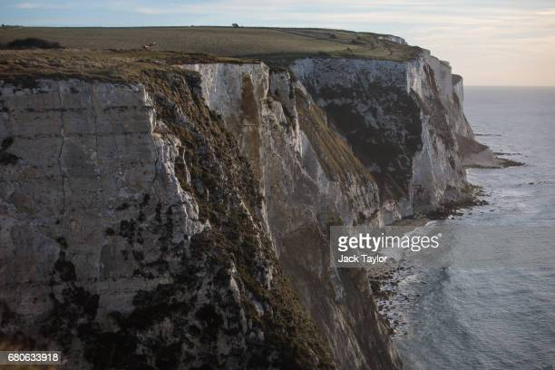 The sun rises over the White Cliffs of Dover on March 21 2017 in Dover England The Port of Dover is Europe's busiest passenger port and the UK's...