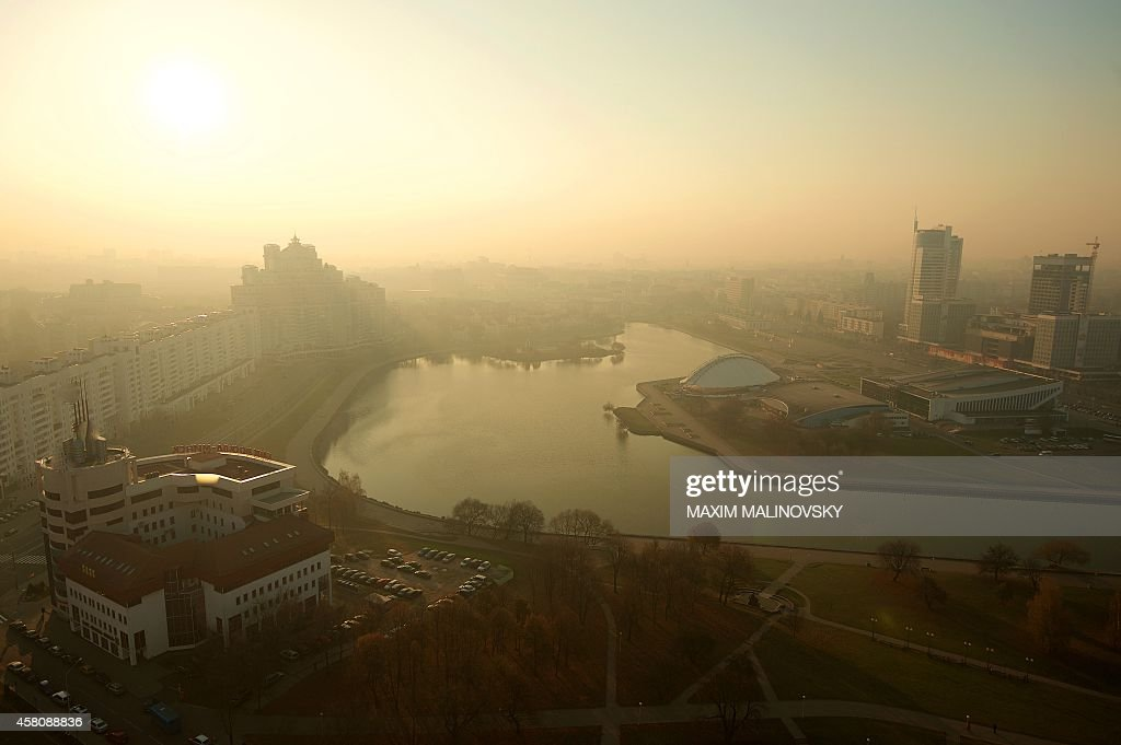 The sun rises through smog over the Belarus capital of Minsk on October 30 2014 AFP PHOTO / MAXIM MALINOVSKY