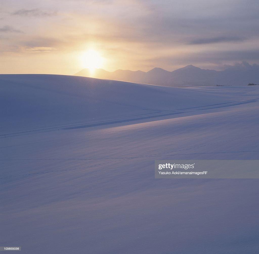 The Sun Rising Over Mt Tokachi And A Snowy Field Hokkaido Japan ...