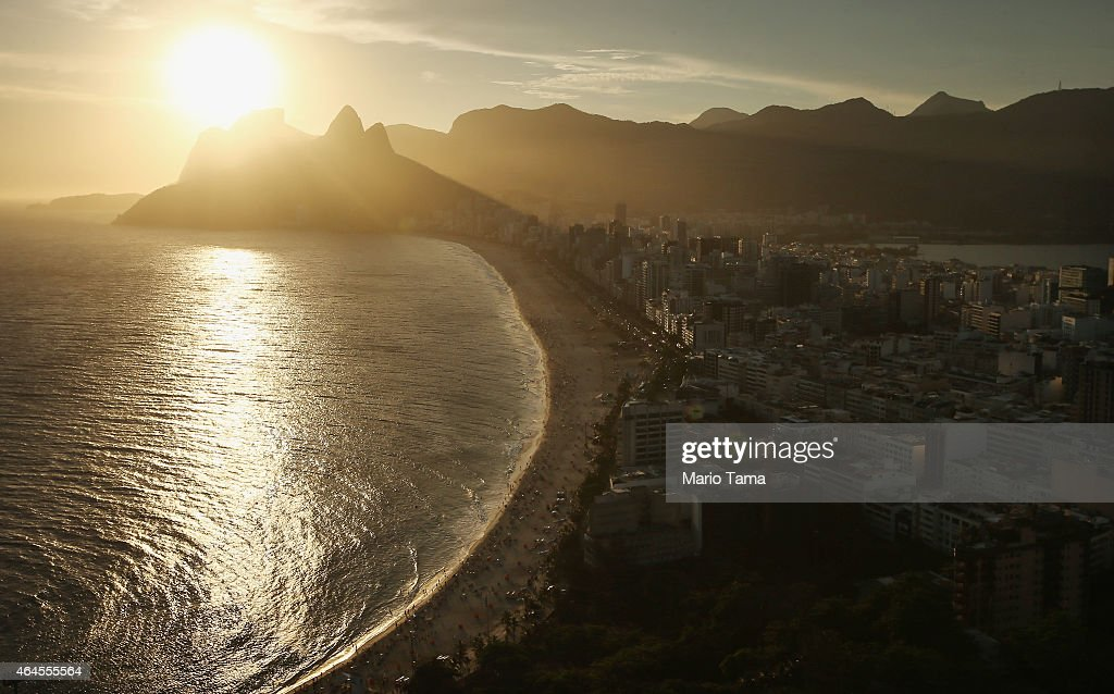 The sun sets above Ipanema beach in an aerial view on February 24, 2015 in Rio de Janeiro, Brazil. Rio marks its 450th anniversary on March 1st and is celebrating the event with a yearlong series of events including concerts, exhibitions, historical tours, soccer matches, fireworks displays and other activities. The 'Marvelous City' was founded in 1565 by the Portuguese and was the seat of power of the Portuguese Empire in the 19th century before serving as the capital of the Brazilian Republic until 1960. The city is BrazilÕs most popular tourist destination and will host the Rio 2016 Olympic Games, the first to be held in South America, next year.
