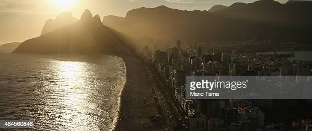 The sun sets above Ipanema beach in an aerial view on February 24 2015 in Rio de Janeiro Brazil Rio marks its 450th anniversary on March 1 and is...